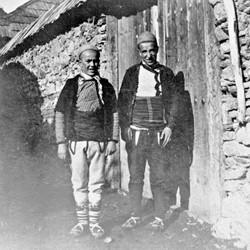 Doda NB9020 69 B Macedonia. Two young men of Shtirovica showing off the opangas (shoes).