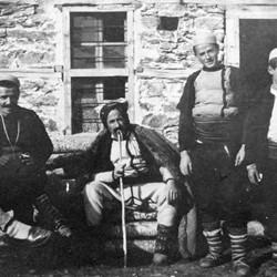 Doda NB9020 75 B Macedonia. Shepherd in a sheepskin cloak with some men from Shtirovica.