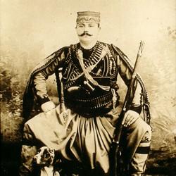 044 Albania. An Albanian man in national costume