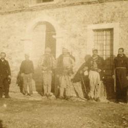 255 Albania. Iballja school building, 1905. The teacher (left), the priest (right), tribesmen (centre)